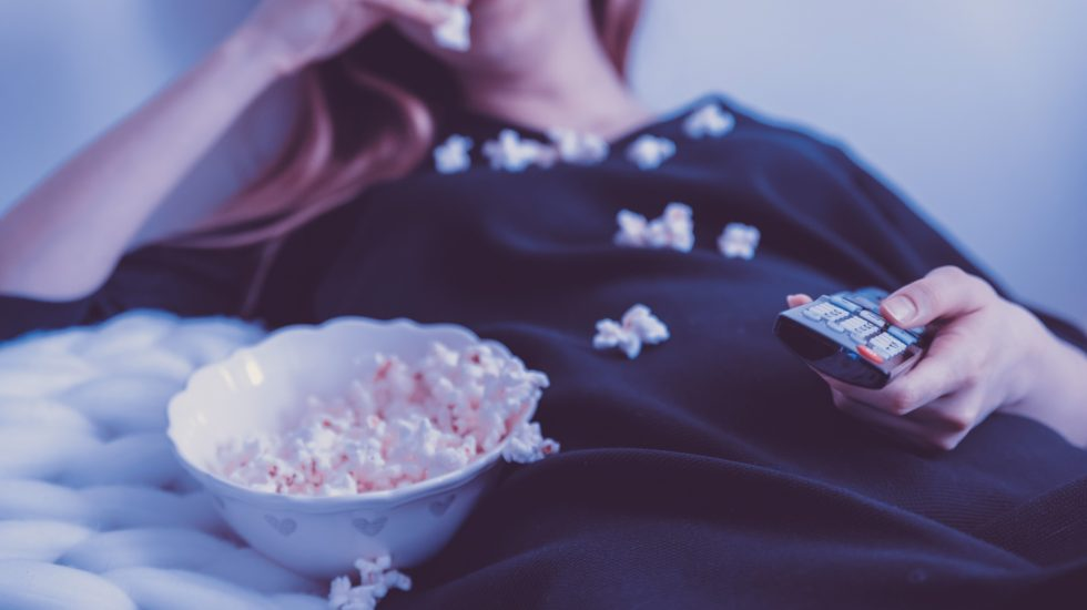 Woman Eating - Escapism vs. Self-Care – How to tell the difference