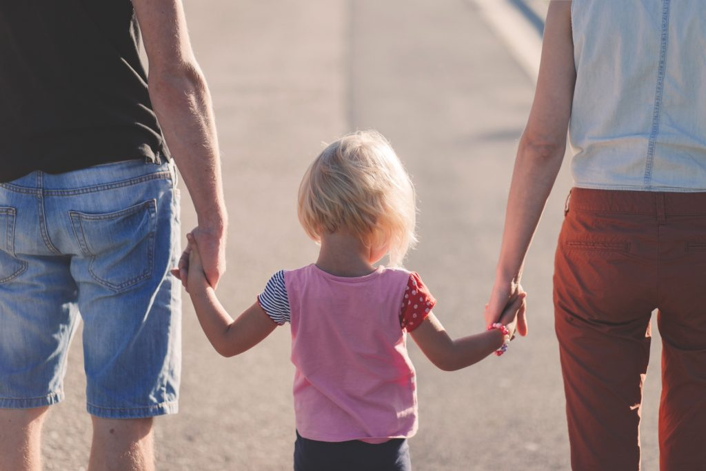 3 people holding hands - Parenting is inconvenient