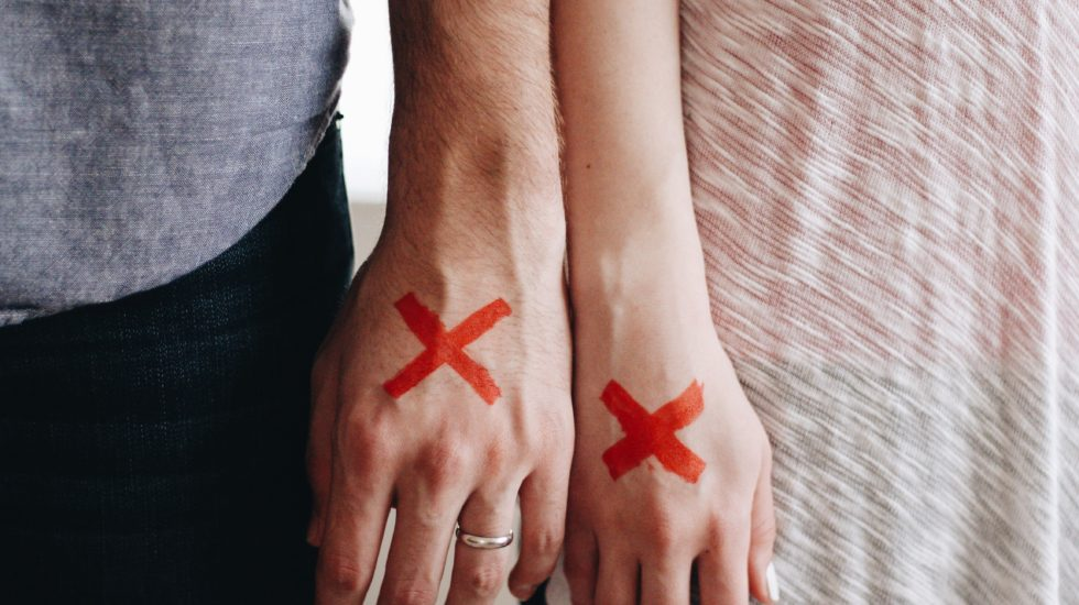 Couple Hands with X - Can your marriage survive cancer?