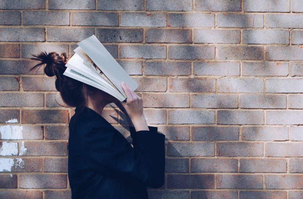 Woman with Book - Motherhood is exhausting