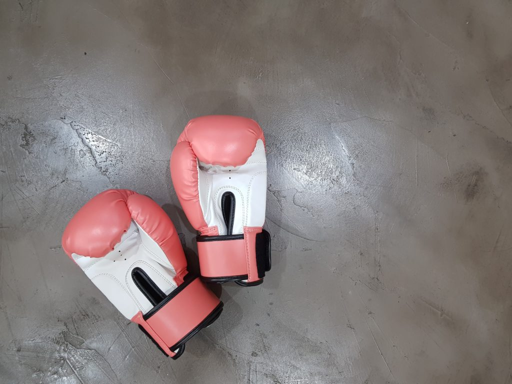 Pink boxing gloves - Are you coping with cancer differently than your spouse?
