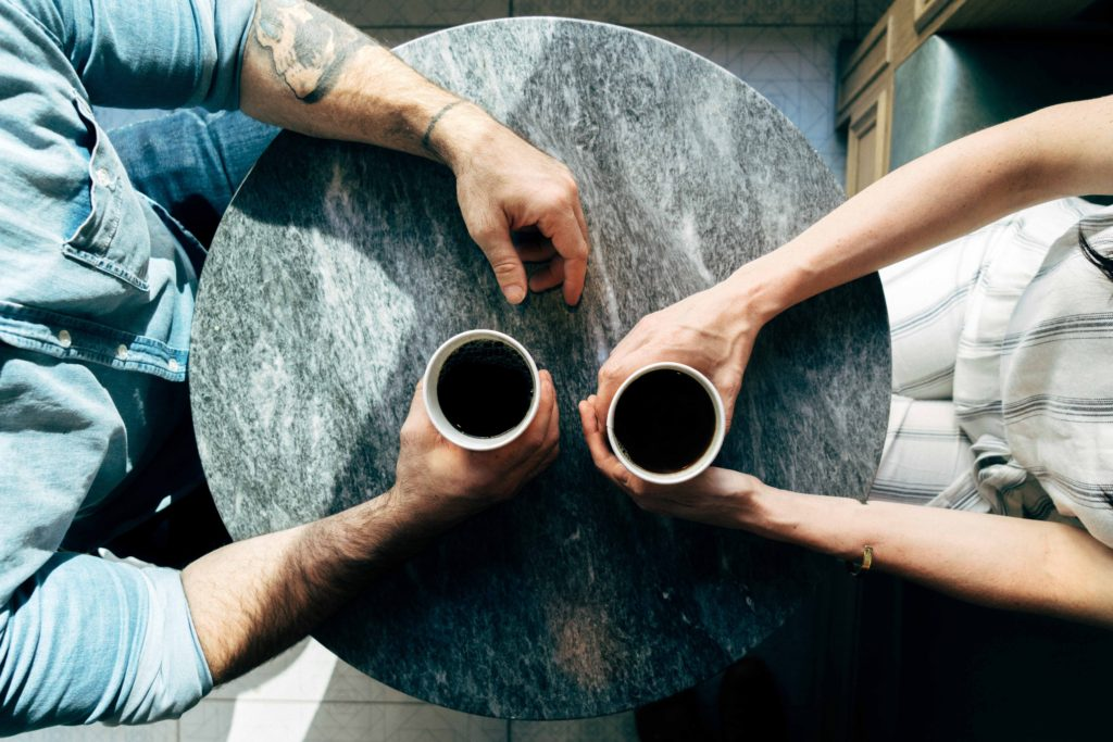Couple Holding Coffee Cups - How to Get Your Husband to Share the Mental Load -