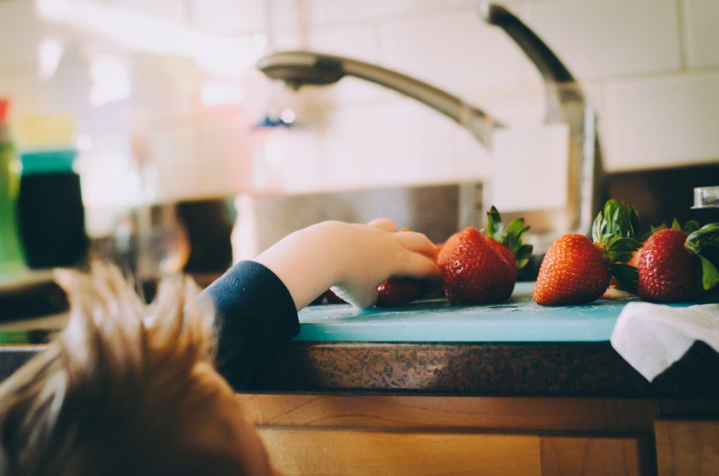Kid & Strawberries - Good food habits are work