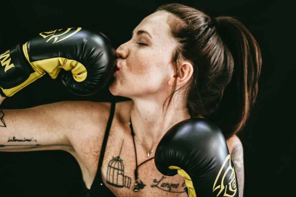 Woman Boxing - Mental Load for Moms is heavy
