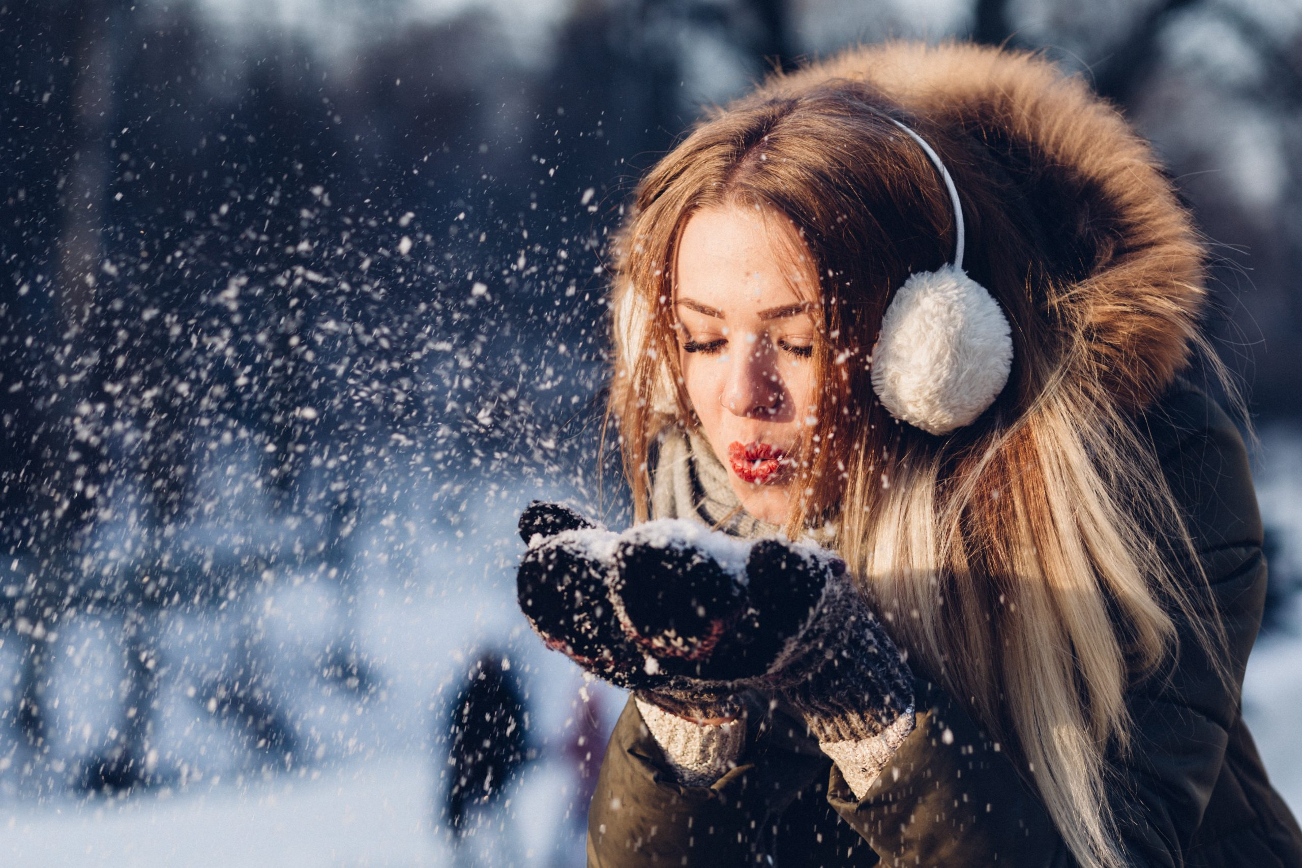 Woman Blowing Snow Flakes - Holiday Stress