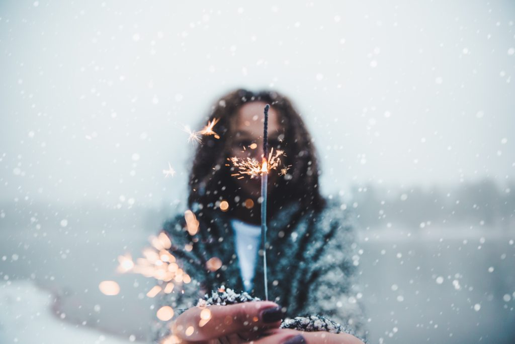 Woman Holding Sparkler - December Self Care Challenge