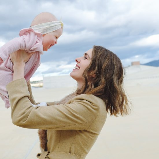 Mom Holding Baby - Secrets of Confident Moms